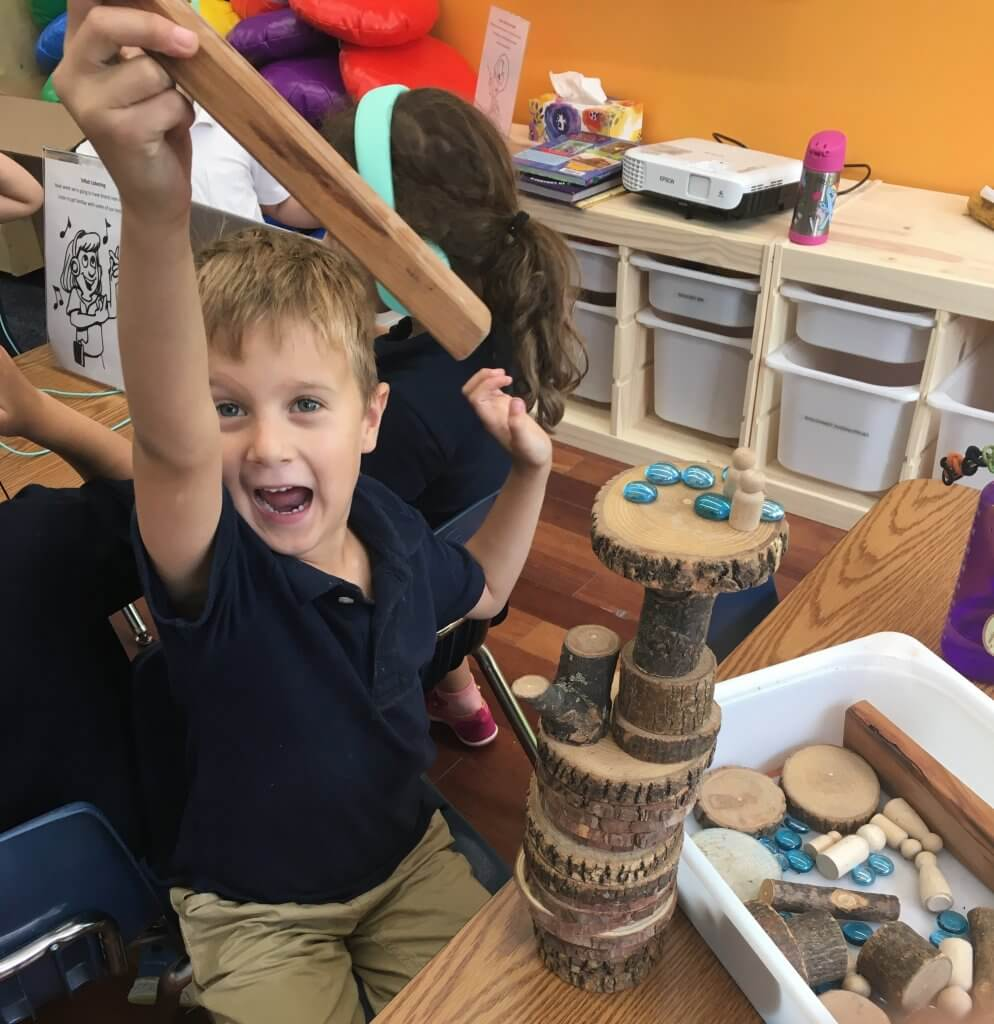 Shorashim (1st grade) student joyfully building