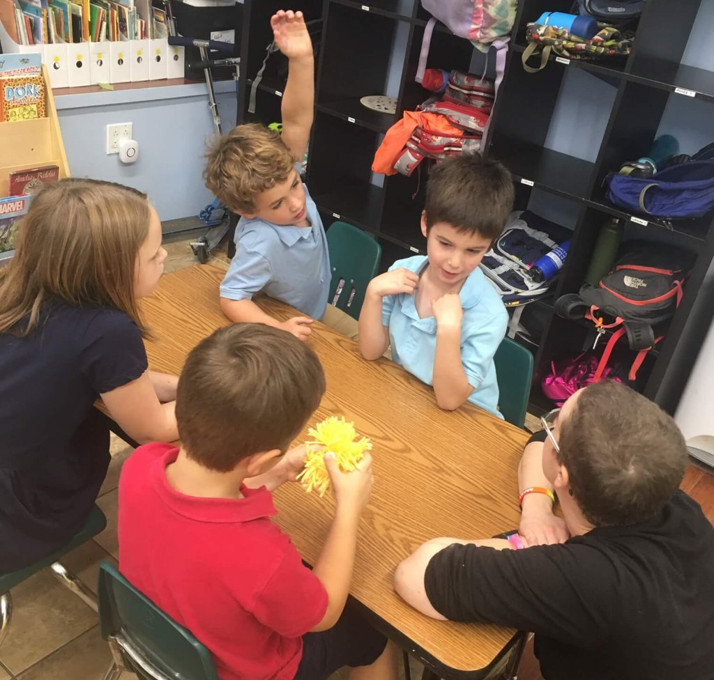 Kiddos discussing moments they are proud of and moments when they missed the mark.