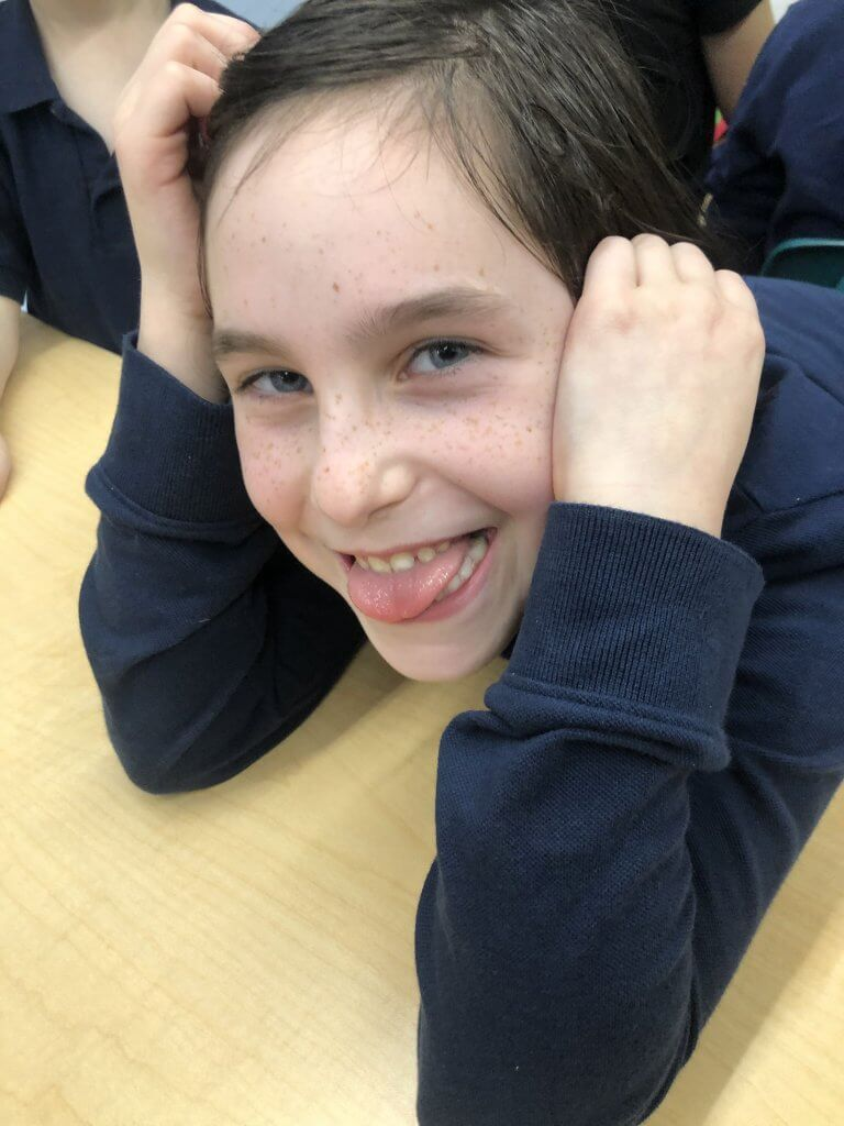 Third grade student contemplating how to show the best version of herself.