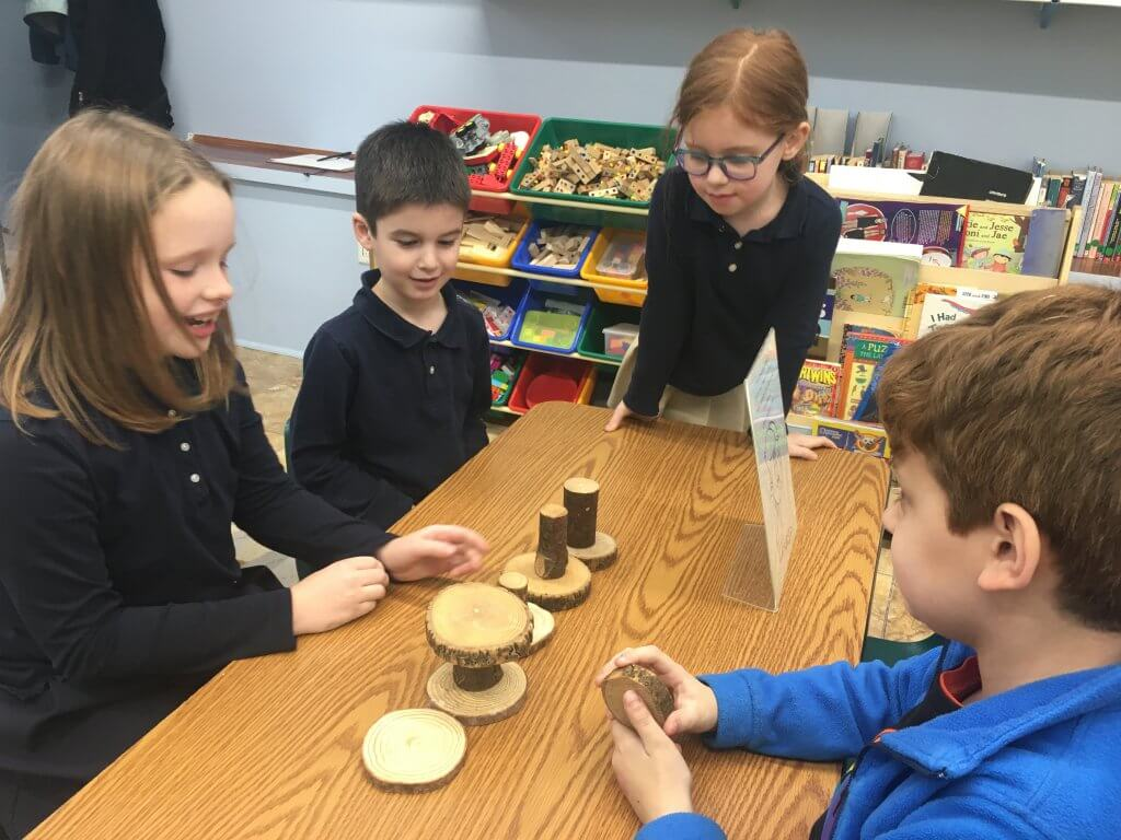 Four students build a block creation as they explore compassion with a drama activity.
