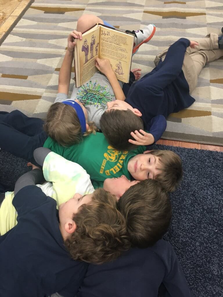 Cuddle pile of kiddos on the carpets.