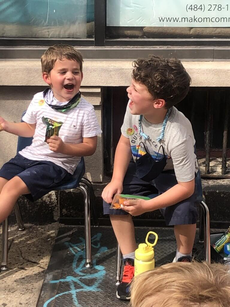 "A first grader and preschooler excitedly call ""tekiya"" to hear the shofar blast"