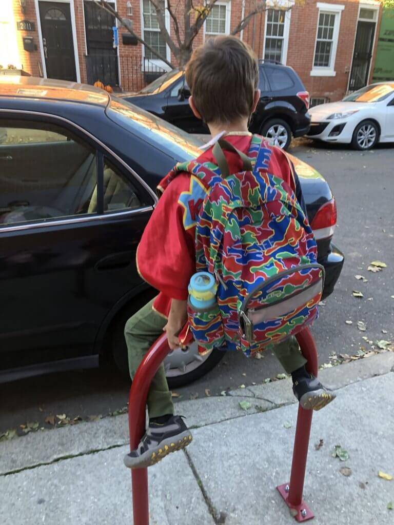 2nd grader sitting on a bike rack outside Chester Arthur.