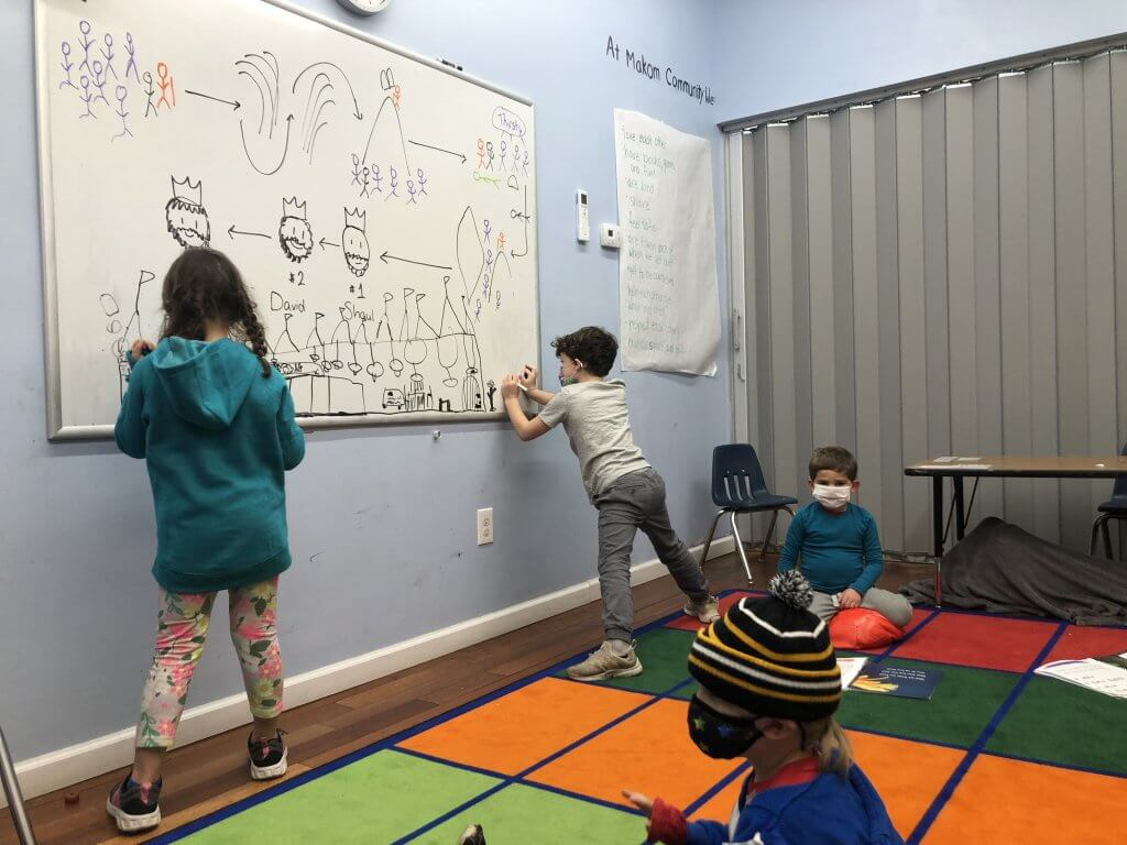 K student and 1st grader illustrate the scene of Shlomo dreaming about talking to God.