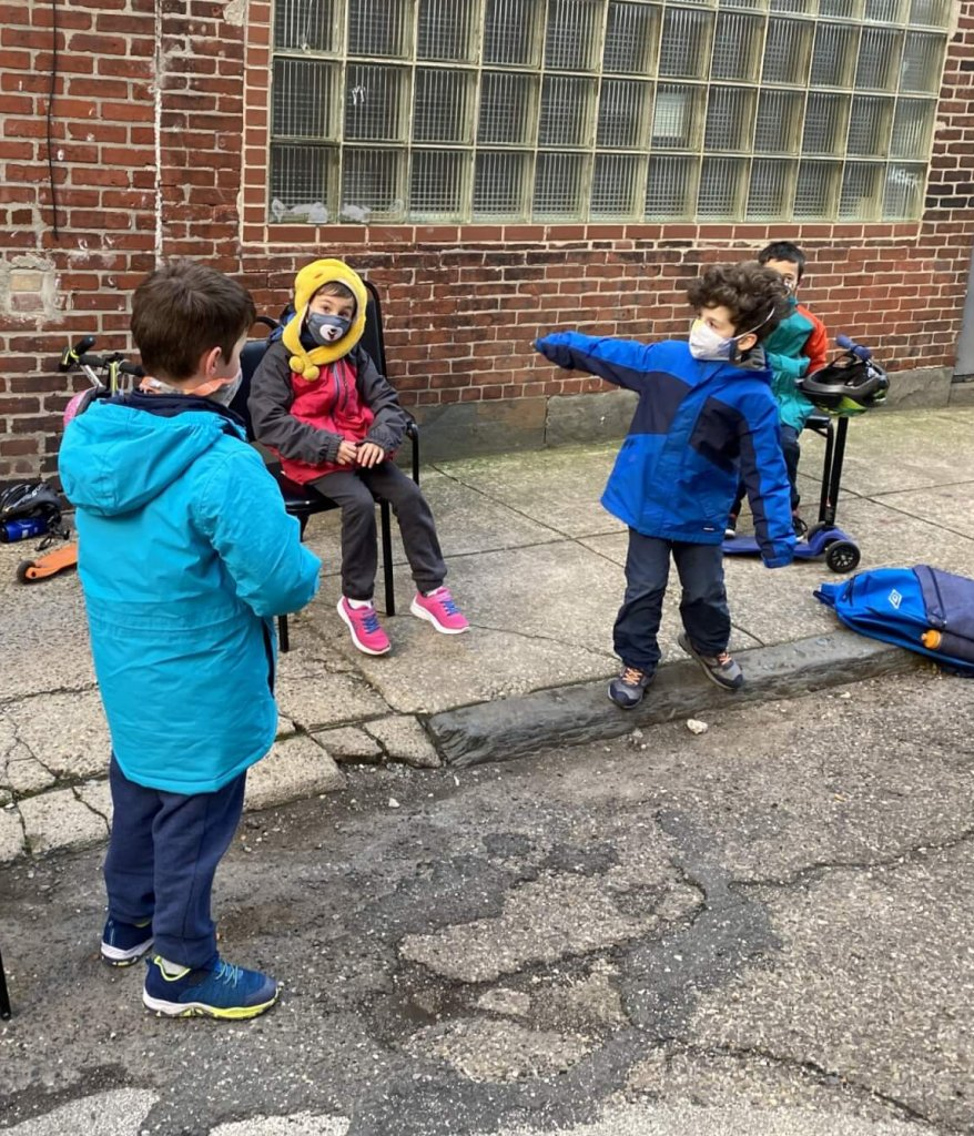 1st and 2nd graders at class outside.
