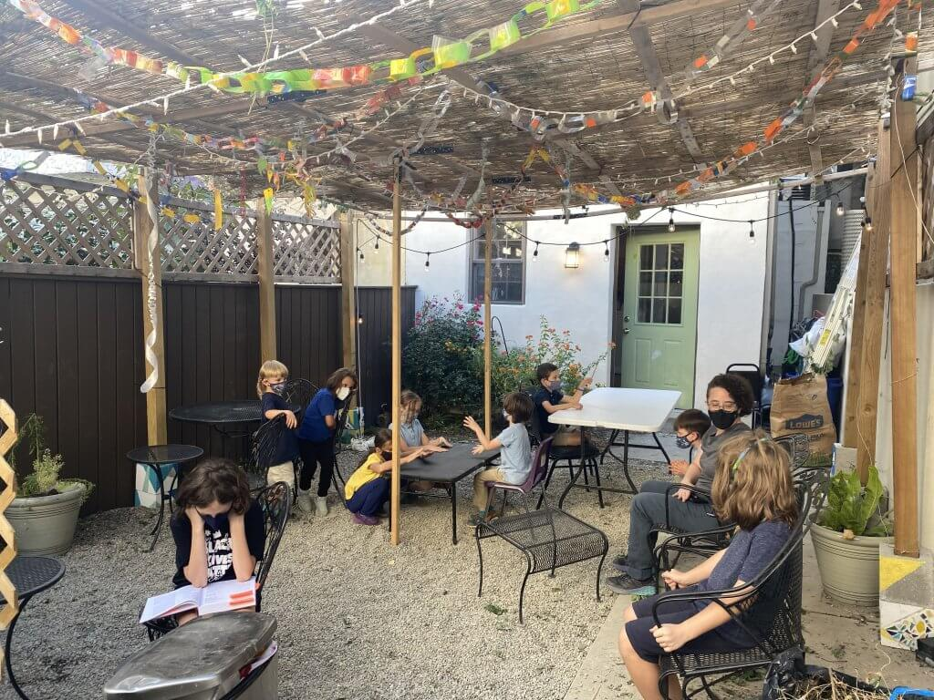 Neighbors and Strangers in the Sukkah